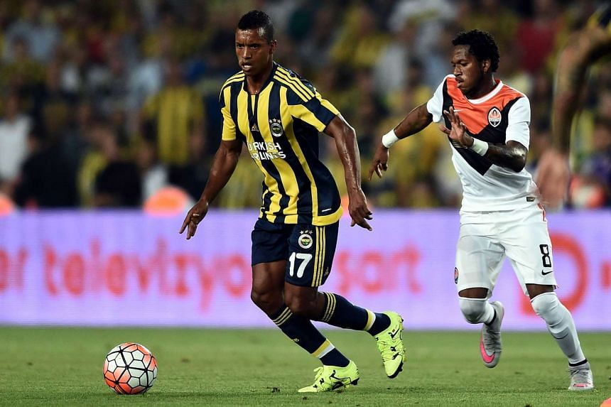 Shakhtar Donetsk midfielder Fred (right) challenges Luis Nani of Fenerbahce for the ball during their UEFA Champions League third round qualifying match at the Sukru Saracoglu Stadium on July 28, 2015 in Istanbul.