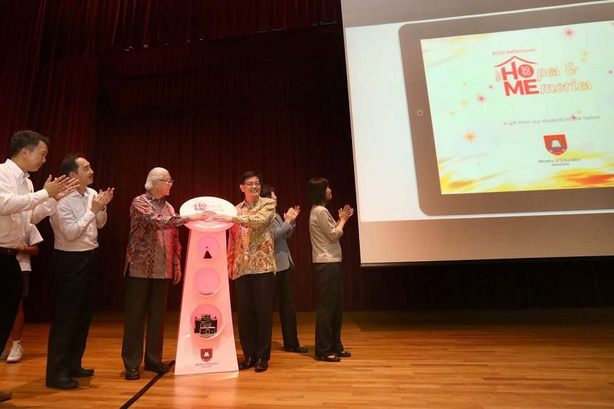 President Tony Tan and Education Minister Heng Swee Keat at the launch of the commemorative e-book.