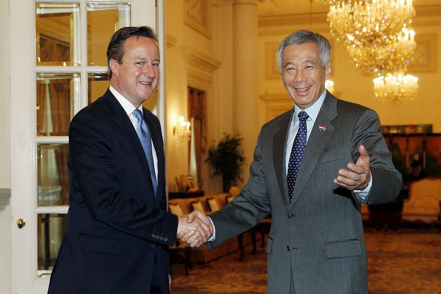 British Prime Minister David Cameron (left) shaking hands with Singaporean PM Lee Hsien Loong during his official visit to the Republic, on July 29, 2015.
