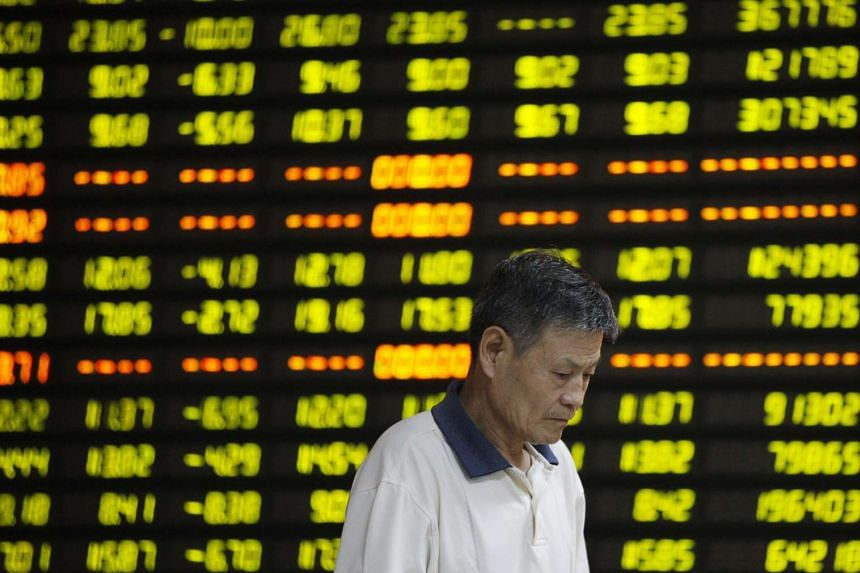 A stock investor checks prices in a brokerage house in Huaibei, central China's Anhui province, July 27, 2015.