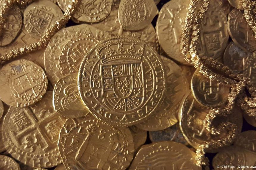 Gold coins and gold chain found in the wreckage of a 1715 Spanish fleet that sunk in the Atlantic off the Florida coast.