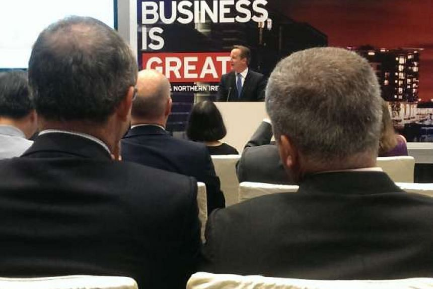 British premier David Cameron speaks to Singapore investors at an event in Singapore on July 29, 2015. PHOTO: RACHAEL BOON
