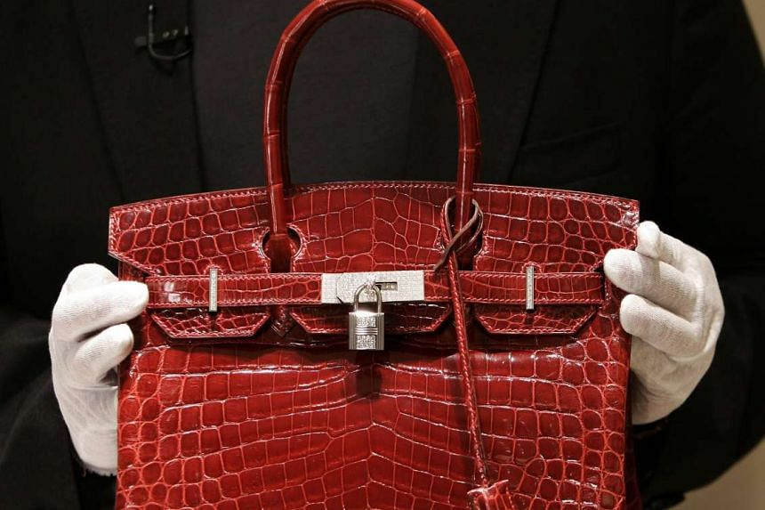 French fashion house Hermes said it was probing claims of cruelty at crocodile and alligator farms that supply the animals' skins for its handbags and other accessories.