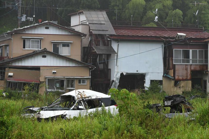 Houses and vehicles damaged by the March 11, 2011 tsunami still remain untouched after four years, in the village of Tomioka, north of Naraha in Fukushima prefecture, in this picture taken on July 16, 2015.