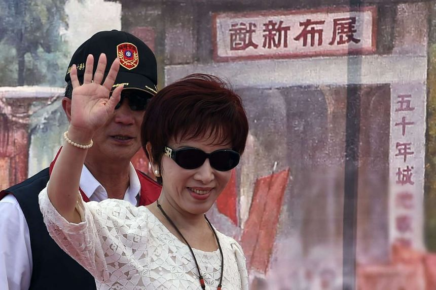 Hung Hsiu-chu, deputy Parliament speaker from the ruling KMT, waves during a ceremony to celebrate the 70th anniversary of the WWII in Taipei on July 5 2015.