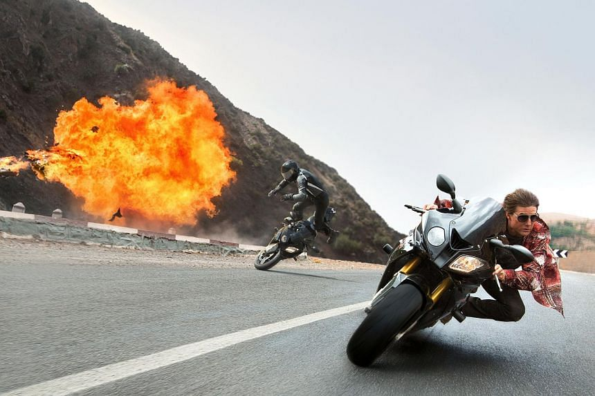Tom Cruise (right) plays Ethan Hunt in Mission: Impossible - Rogue Nation.