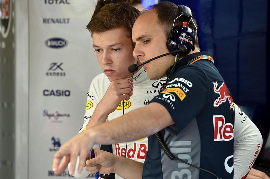 Max Verstappen (left) talks with a mechanic in the pits during the second practice session at the Silverstone circuit in Silverstone.