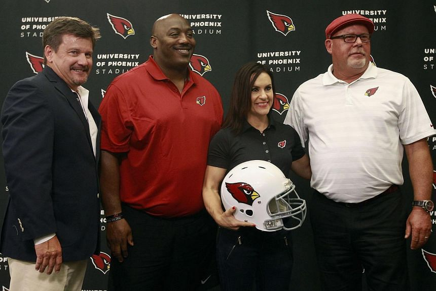 Arizona Cardinals team president Micheal Bidwill (left) and head coach Bruce Arians stand with Levon Kirkland and Jen Welter after they where introduced as additions to the team's coaching staff.