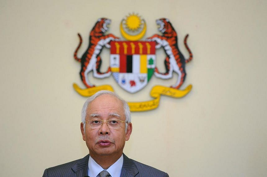 Malaysia's Prime Minister Najib Razak addresses a press conference at the Prime Minister's office in Putrajaya on July 28, 2015, following a cabinet reshuffle.