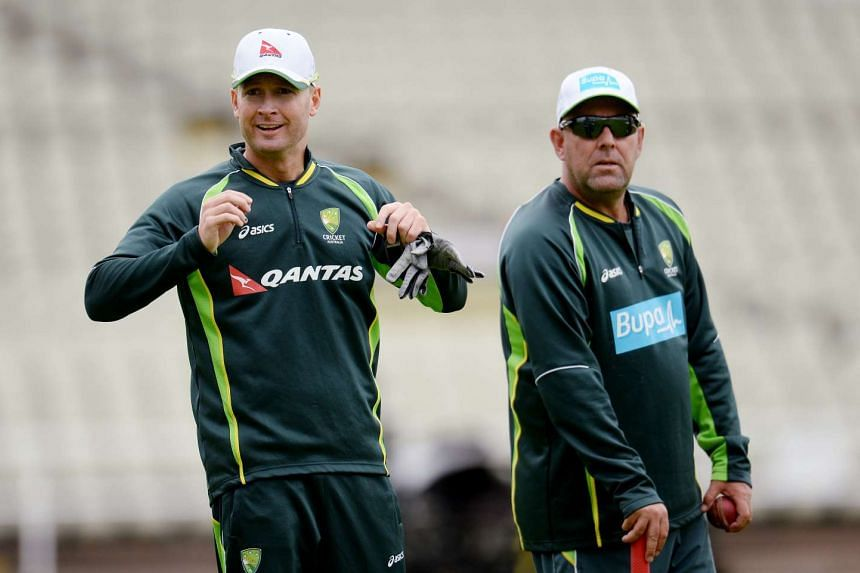 Australia's Michael Clarke and coach Darren Lehmann during a training session.