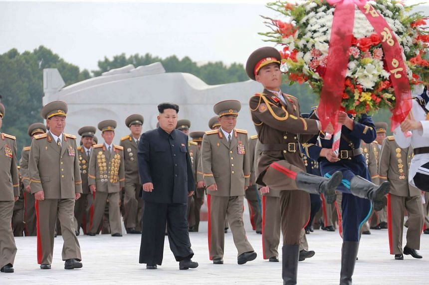 North Korean leader Kim Jong Un pays tribute to fallen fighters of the Korean People's Army in a photo released on July 28, 2015.