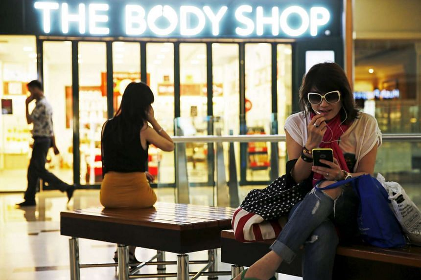 A woman uses her smartphone at the Grand Indonesia mall in Jakarta, Indonesia.