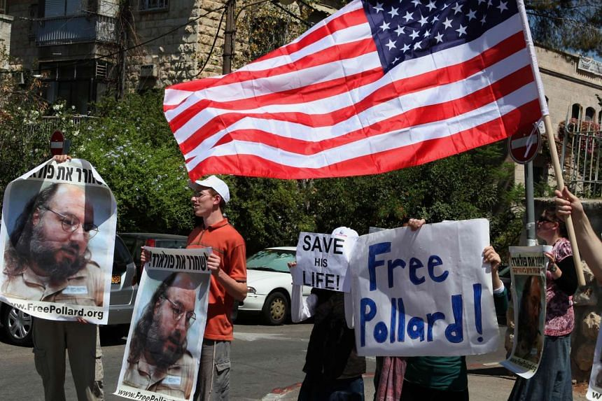 A 2011 file photo shows Israeli activists as they hold up pictures of Jonathan Pollard.