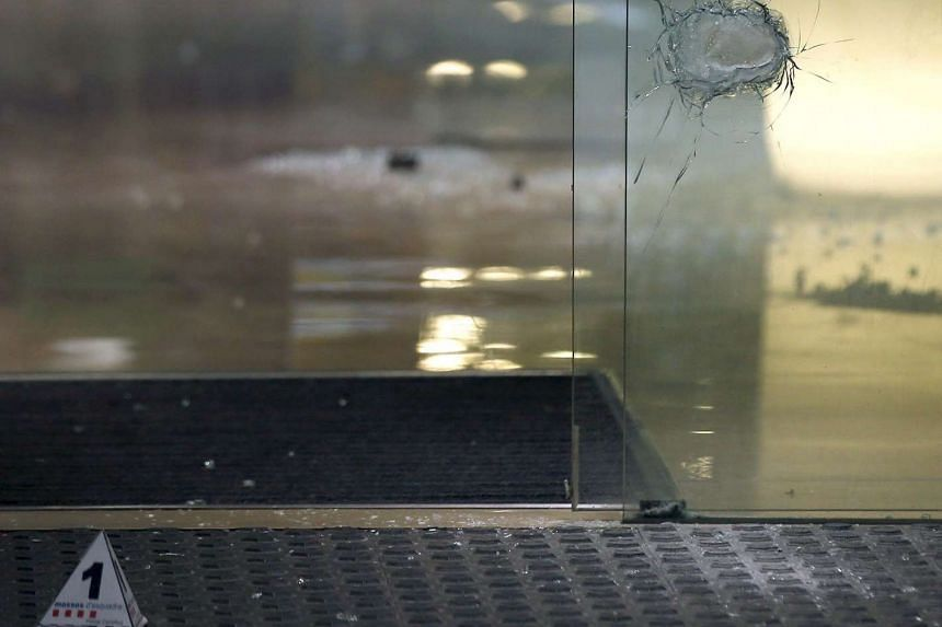 View of bullet damages at the Silken Hotel where a man began shooting and left two people injured in Barcelona, Spain.