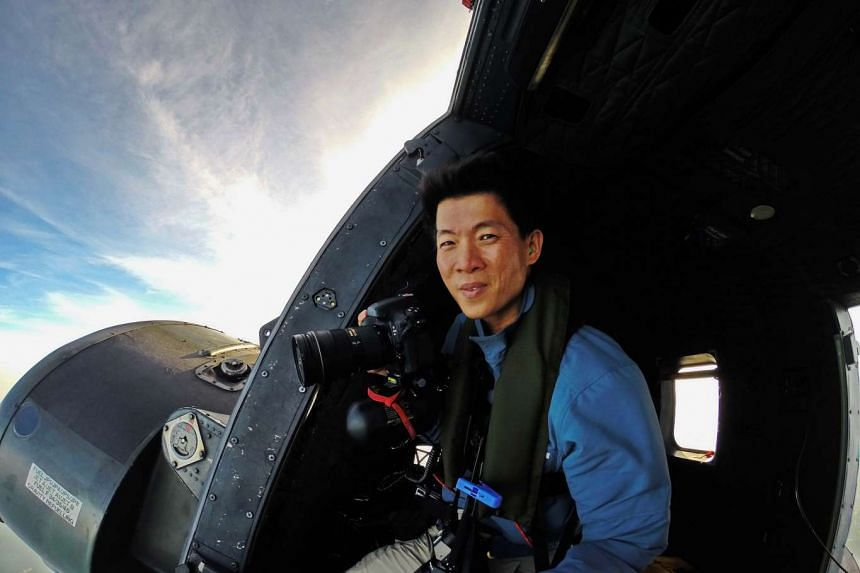Richard Koh (above) took the aerial photos for Over Singapore, which includes a picture of HDB flats in Choa Chu Kang.
