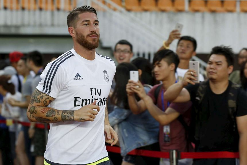 Sergio Ramos training at Tianhe Stadium in Guangzhou, China during Real's pre-season tour. The defender is now likely to ink a new contract and remain at the Spanish giants, after two bids from United were rejected.