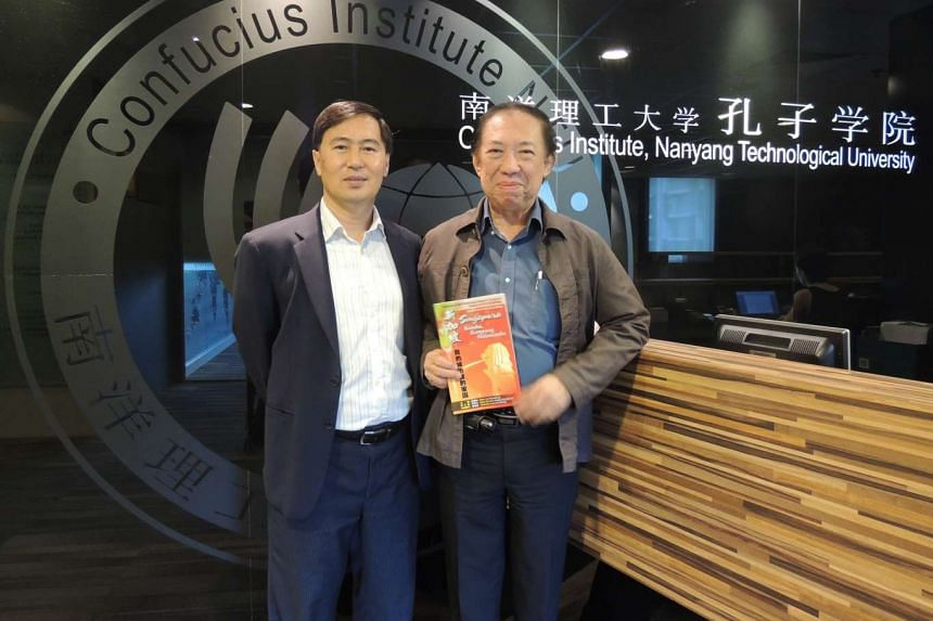 CI-NTU director Neo Peng Fu said the poetry book was the brainchild of Professor Leo Suryadinata (right), a former director of the Chinese Heritage Centre. Prof Leo translated the Malay poems into Chinese, and the Chinese poems into Malay, for the sp