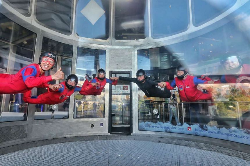 Team leader Major Arnold Low (left) with his fellow Red Lions demonstrating some mid-air moves at the iFly Singapore wind tunnel, where they sometimes train.