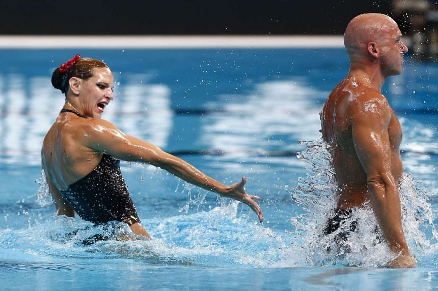 Benoit Yves Beaufils (right) and Virginie Dedieu of France perform during the Synchronized Swimming Mixed Duet Free Routine Preliminary of the FINA Swimming World Championships at the Kazan arena in Kazan, Russia, on July 28, 2015.