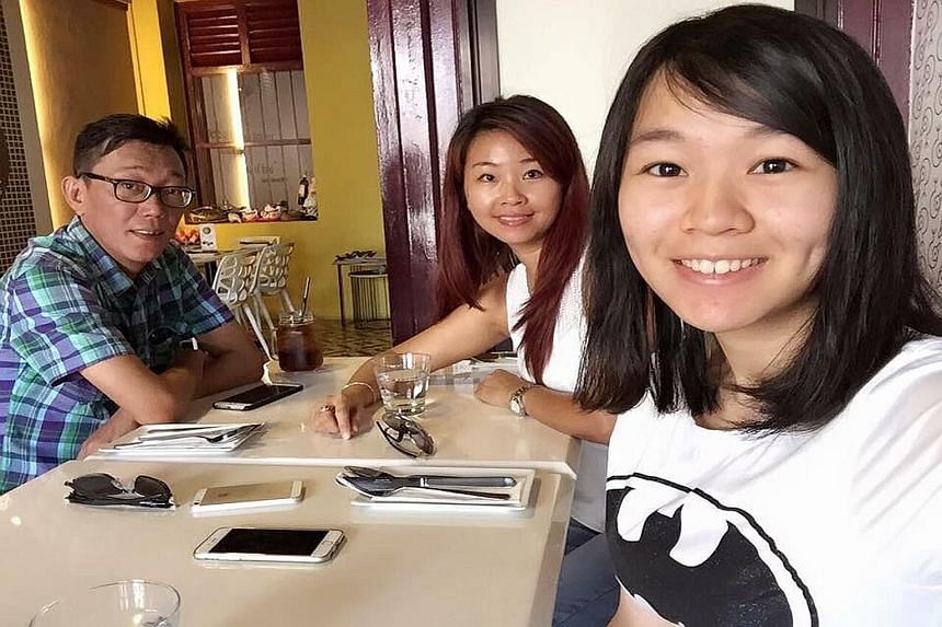 Carmen Mark (right), 18, with her mother Ariess Tan, 41, and father Mark Kok Wah, 44. An only child, Carmen collapsed suddenly on July 3 while having lunch at Nanyang Polytechnic, where she was studying under a nursing scholarship from the National H