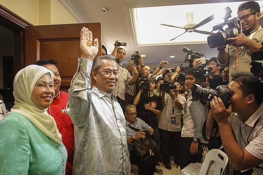 Mr Muhyiddin Yassin, seen here with his wife Noraini Abdul Rahman, at a press conference at his home in Bukit Damansara yesterday. He urged his supporters not to cause trouble for the country even though they were upset that he had been sacked as dep
