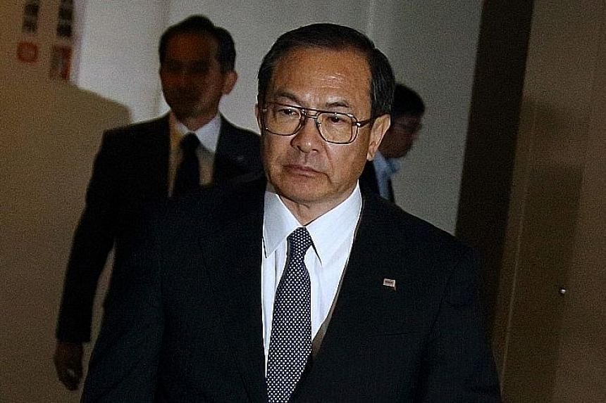 Mr Masashi Muromachi arriving for a meeting with a revitalisation committee at Toshiba's Tokyo headquarters yesterday.