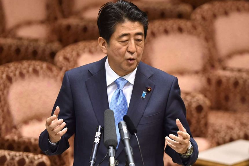 Japan's Prime Minister Shinzo Abe answers questions during an upper house special committee session at the parliament in Tokyo on July 28, 2015.