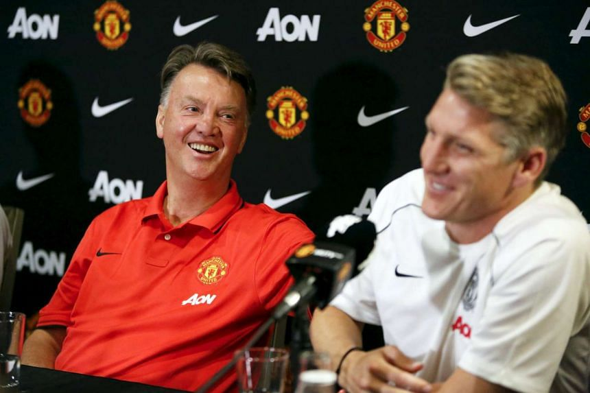 Louis van Gaal (left) and player Bastian Schweinsteiger speak to the media at a news conference in Bellevue, Washington on July 15, 2015.