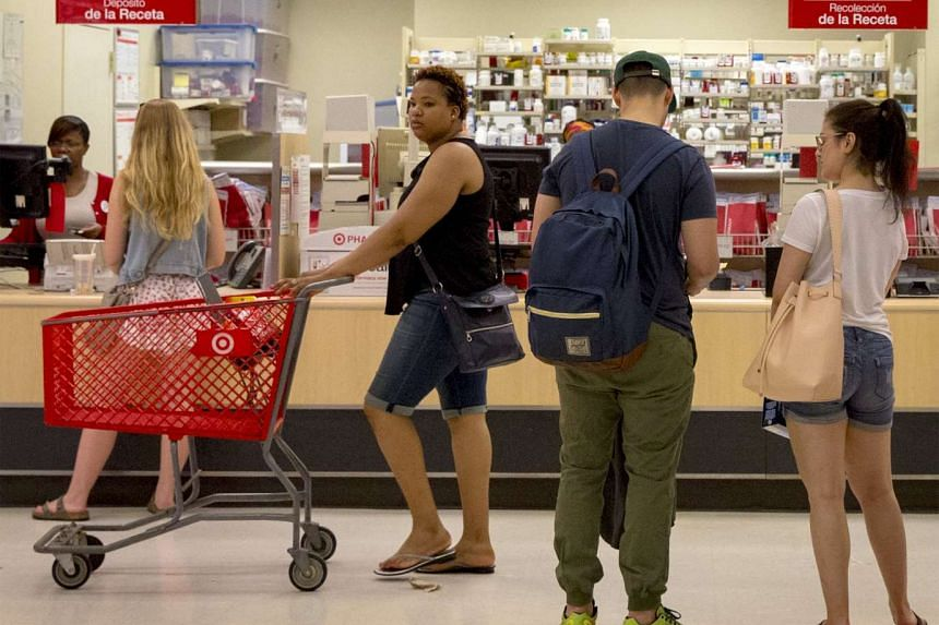 Pedestrians carry Macy's Inc. shopping bags in San Francisco, California, on Jan 22, 2015.