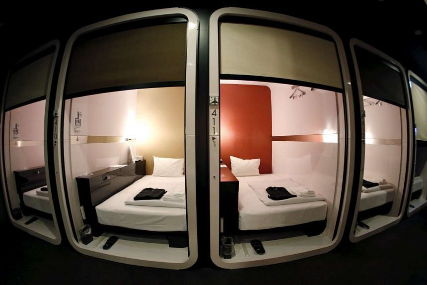 """""""Business-class"""" cabins are seen at First Cabin hotel, which was converted from an old office building, in Tokyo."""