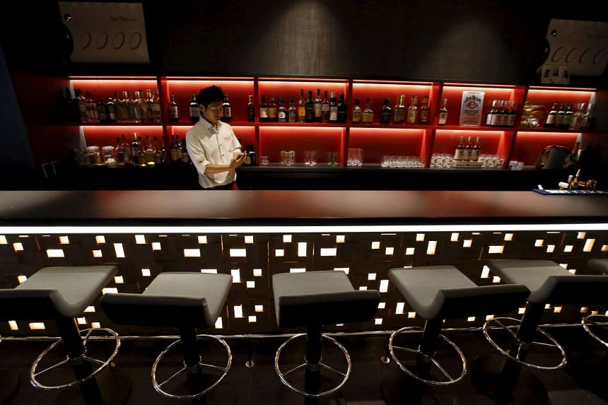A waiter works in a bar at First Cabin hotel, which was converted from an old office building, in Tokyo.