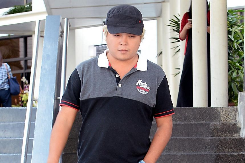 Jover Chew leaving the court on May 29, 2015. Chew now faces 28 charges, including fresh ones of insulting behaviour and conspiracy to cheat.