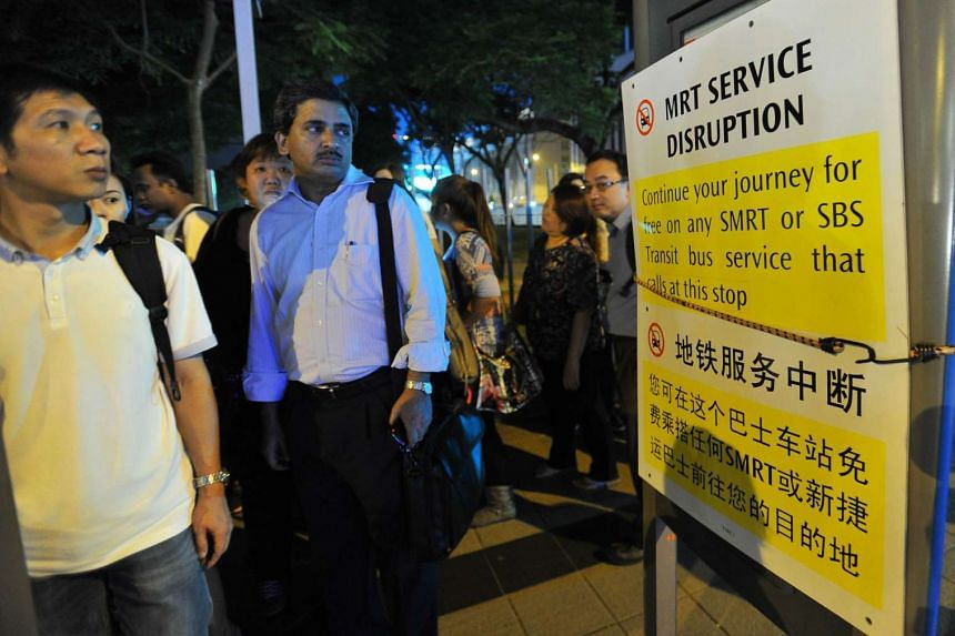 Information signs outside City Hall MRT station during breakdown of MRT service on July 7, 2015.