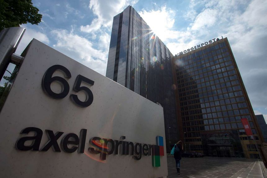 Axel Springer shares dropped two percent on reports that it was bidding for the FT.