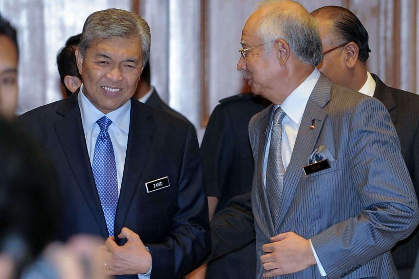Malaysia's Prime Minister Najib Razak (right) with newly appointed Deputy Prime Minister Ahmad Zahid Hamidi (left) at the premier's office in Putrajaya on July 28, 2015.