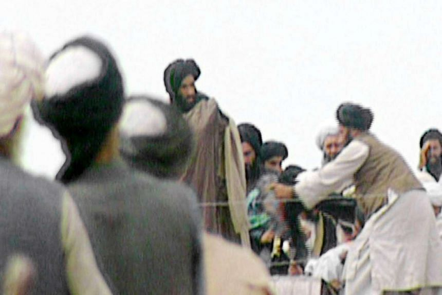 A TV screengrab of footage taken secretly by BBC Newsnight which claims to show Mullah Omar (centre) during a rally for his troops in Kandahar in 1996.