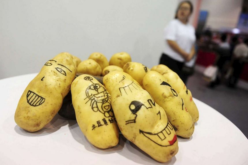 Potatoes painted with faces and cartoons on display at the World Potato Congress on July 28, 2015.