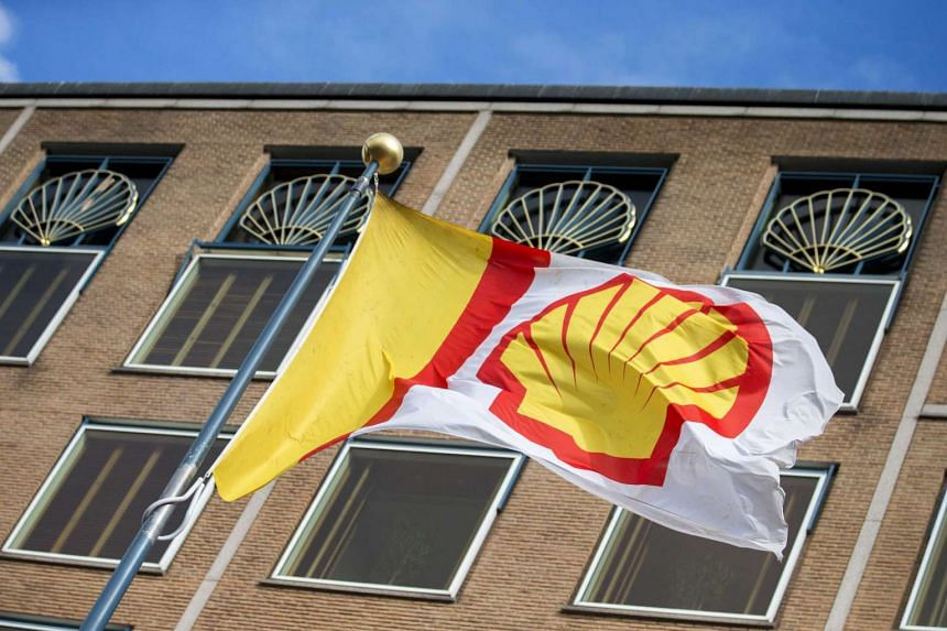 A file picture of the head office of Royal Dutch Shell i The Hague, The Netherlands. Shell is to axe 6,500 jobs this year and step up spending cuts, it announced after profits fell in the second quarter. PHOTO: EPA