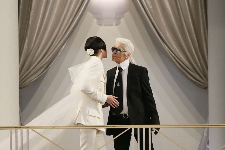 Fashion designer Karl Lagerfeld (right) uses Klorane Dry Shampoo to make his grey hair look completely white.