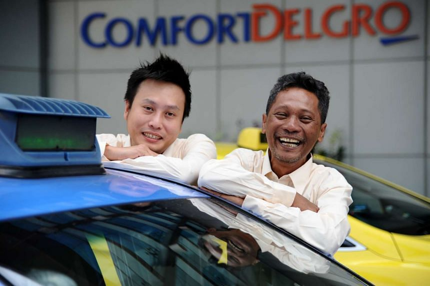 Taxi drivers Lim Teck Chuan (left) and Mazlan Mahan risked their lives to help a woman whose car caught fire after it had stopped on the Tampines Expressway last month. The driver apparently had no idea that flames were escaping from the car's bonnet