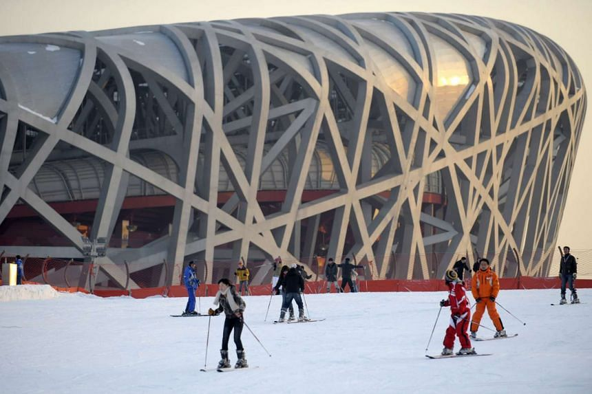 Beijing, if it earns the nod over Almaty in Kazakhstan, will become the first city to host the summer and winter Olympics. This 2010 photo shows skiers outside the National Stadium, but the city's 2022 Games bid will rely on natural snowfall augmente