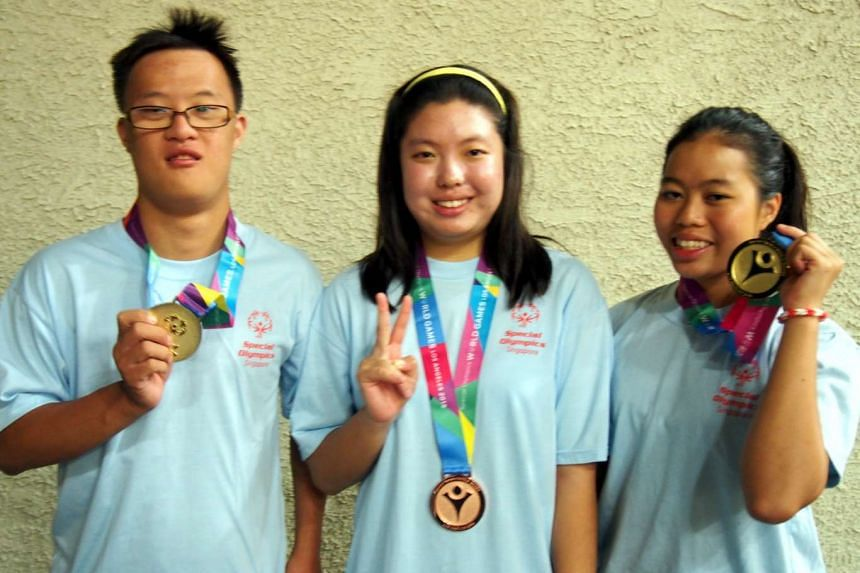 Singapore swimmers Danielle Moi (right), Bryan Seow (left) and Nicole Fu.