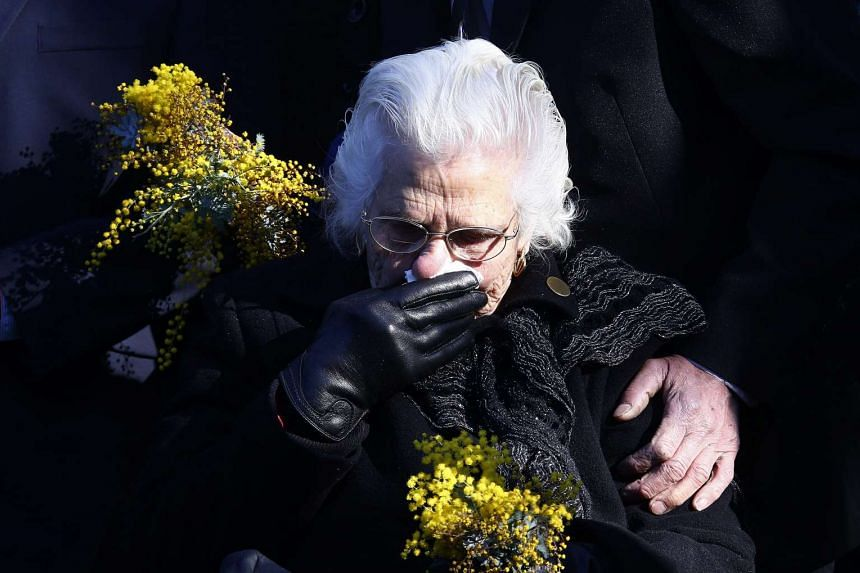 A relative of an Australian victim reacts at a memorial service for those who died aboard MH17.