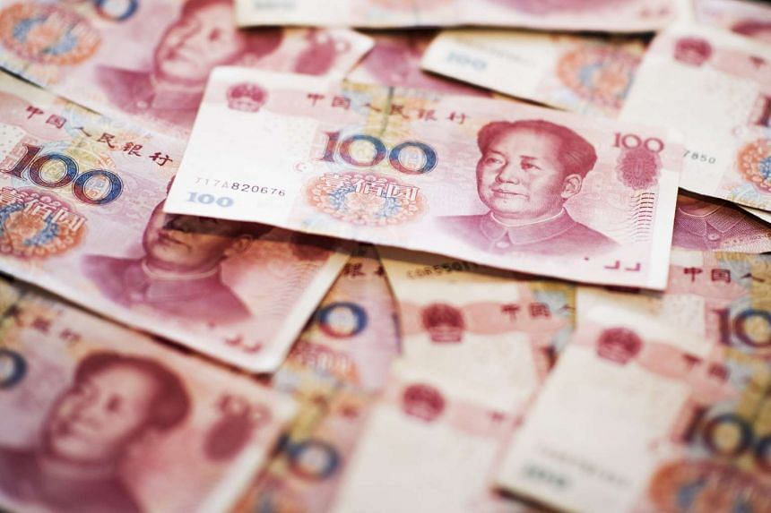 The People's Bank of China is holding the onshore version of the yuan at about 6.2 to the US dollar even as it pledges a bigger role for market forces.