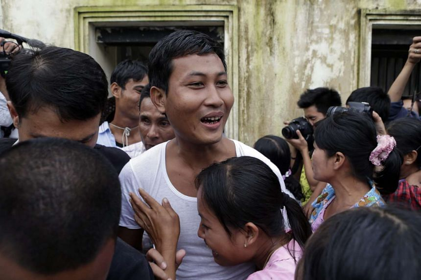 A prisoner is greeted by his family members outside Insein prison in Yangon, Myanmar on July 30, 2015.
