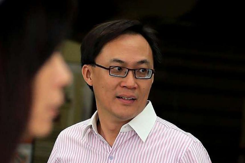 Former senior bank executive Yuen Kum Fai, 45, who was convicted of filming an upskirt video of a woman, was fined $6,000 on Friday. ST PHOTO: WONG KWAI CHOW