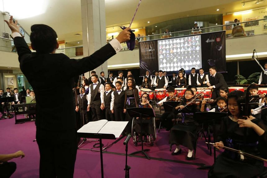 The Purple Symphony performs during its launch at the atrium of the Singapore Conference Hall on July 31, 2015.