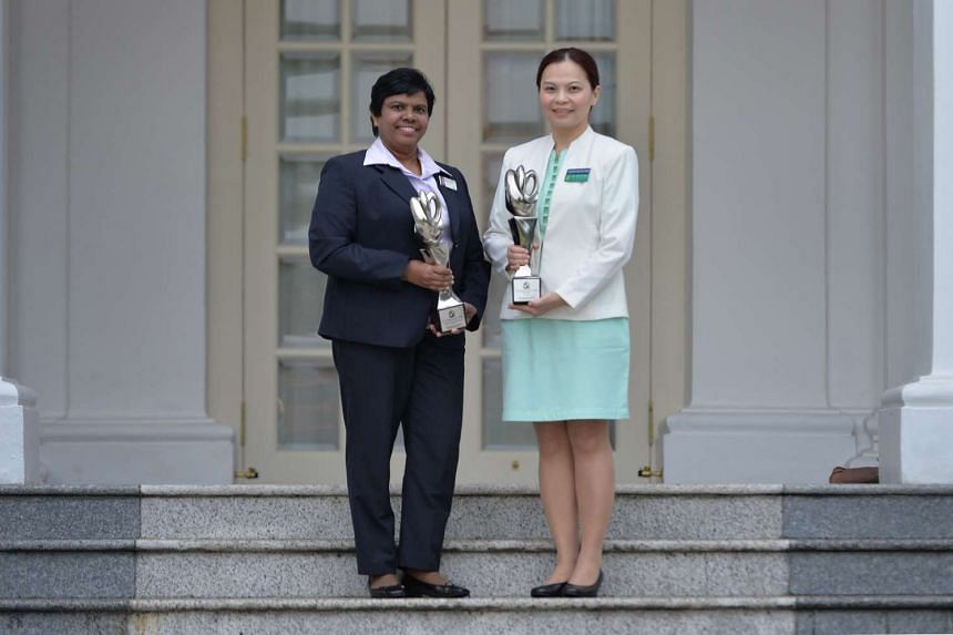 Two of the award winners, Velusamy Poomkothammal (left) and Dr Lim Su-Fee (right).