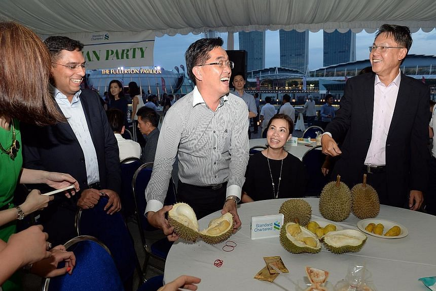 Standard Chartered Bank threw an invitation-only durian party for its clients over two nights earlier this week. The 10th annual durian party, held at Clifford Square, served up a record two tonnes of durians, along with other fruits such as mangoste