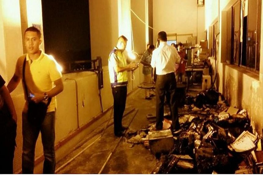 (Left) A picture posted on social media shows the apparent aftermath of the fire on Wednesday at the police headquarters. Police chief Khalid Abu Bakar (above) says only unimportant documents were destroyed in the blaze.